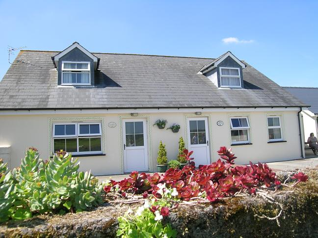 Mefysen and Gwyddfid cottages. Picnic area. Mefysen 4 bedroom cottage, Gwyddfid 3 bedroom cottage.