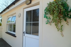 The front entrance with flowers in the hanging basket