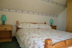 The upstairs bedroom with double bed